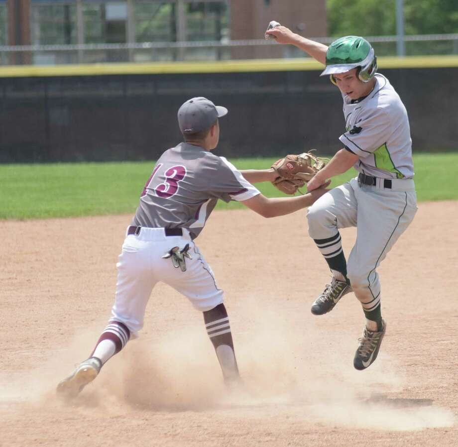 Norwalk's Tyler LaFranco, right, is tagged out at third base by Naugatuck's Jonathan Chatfield during Saturday's CIAC Class LL preliminary game in Naugatuck. Norwalk won 9-3. Photo: John Nash/Hearst Connecticut Media
