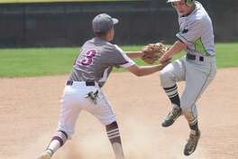 Norwalk's Tyler LaFranco, right, is tagged out at third base by Naugatuck's Jonathan Chatfield during Saturday's CIAC Class LL preliminary game in Naugatuck. Norwalk won 9-3.