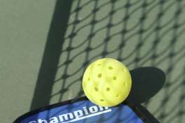 SPORTS: Pickleball combines badminton and tennis, using a tennis-like court and a whiffle ball.