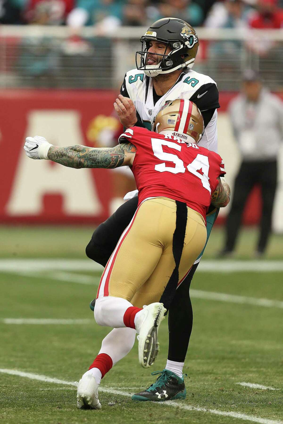 SANTA CLARA, CA - DECEMBER 24: Jacksonville Jaguars quarterback Blake Bortles (5) takes a hit from Cassius Marsh after throwing a pass during an NFL game against the San Francisco 49ers on Sunday December 24, 2017, at Levi's Stadium in Santa Clara, CA. (Photo by Daniel Gluskoter/Icon Sportswire via Getty Images)