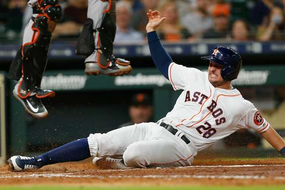 HOUSTON, TX - MAY 22:  J.D. Davis #28 of the Houston Astros scores in the fourth inning on a single by Tony Kemp #18 aSan Francisco Giants at Minute Maid Park on May 22, 2018 in Houston, Texas.  (Photo by Bob Levey/Getty Images)