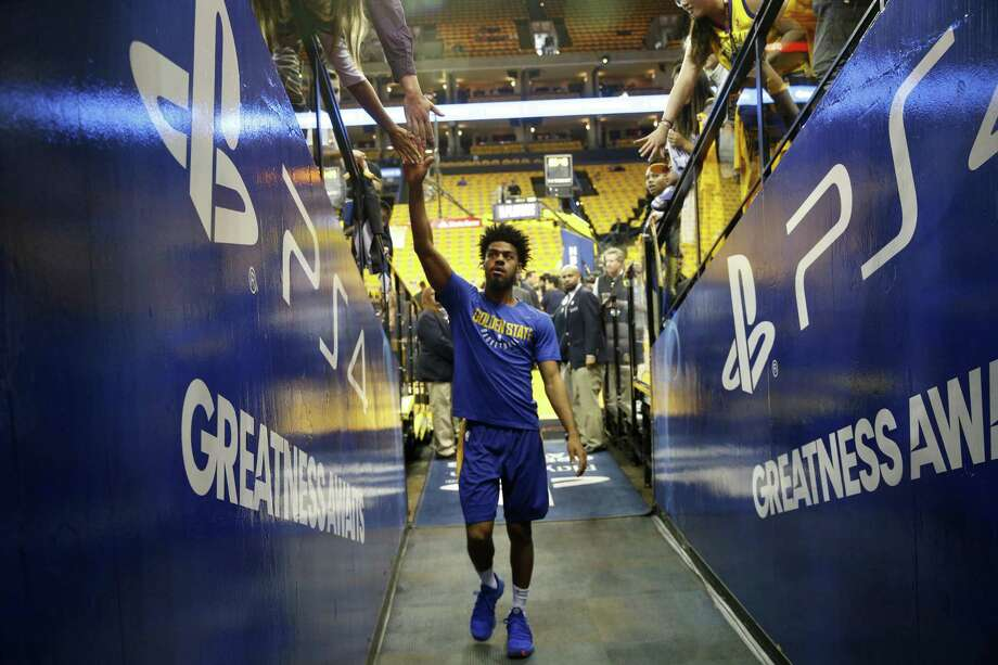 Warriors Quinn Cook,4 heads for the locker room during warm ups before the start of the game, as the Golden State Warriors prepare to take on the San Antonio Spurs in game 5 in the first round of the Western Conference Finals in NBA playoffs in Oakland Calif. on Tues. April 24, 2018. Photo: Michael Macor / The Chronicle / ONLINE_YES