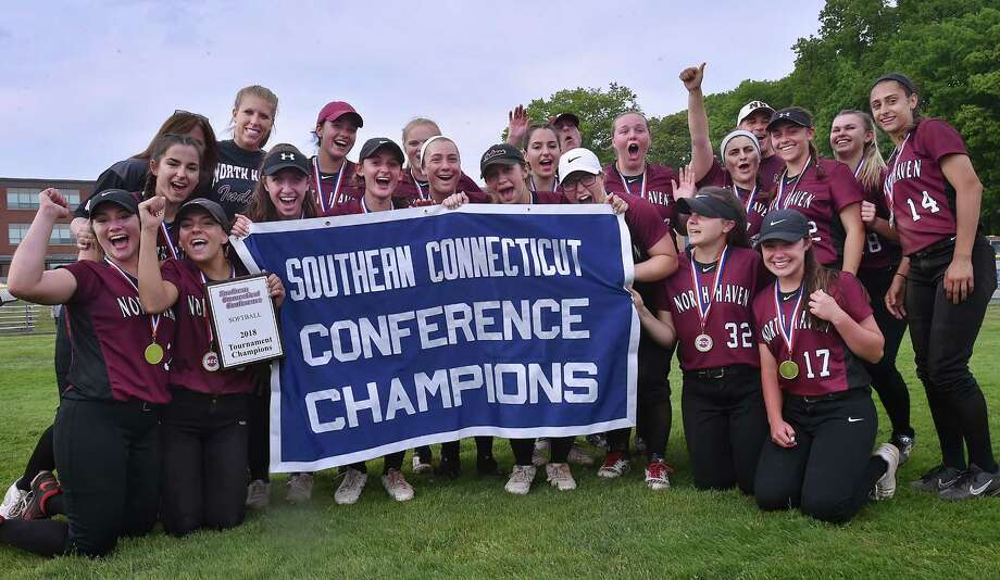 North Haven celebrates their 12-8 win over Amity for the SCC softball championship title, Saturday, May 26, 2018, at Frank Biondi Field at West Haven High School. Photo: Catherine Avalone, Hearst Connecticut Media / New Haven Register