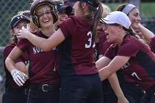 North Haven junior Olivia Petersen, left, is greeted by her teammates after hitting a home run against Amity on Saturday.