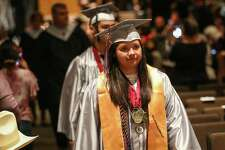 Hauke valedictorian Lacey Flores enters the auditorium during the W.L. Hauke High School graduation on Saturday, May 26, 2018, at Conroe High School.