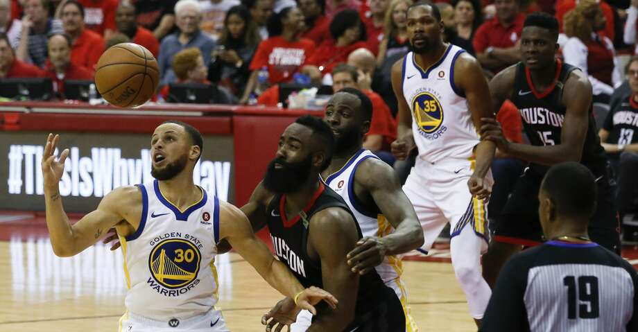 Golden State Warriors guard Stephen Curry (30) scrambles for a loose ball during Game 5 of the Western Conference Finals at Toyota Center, Thursday, May 24, 2018, in Houston.  ( Karen Warren  / Houston Chronicle ) Photo: Karen Warren/Houston Chronicle
