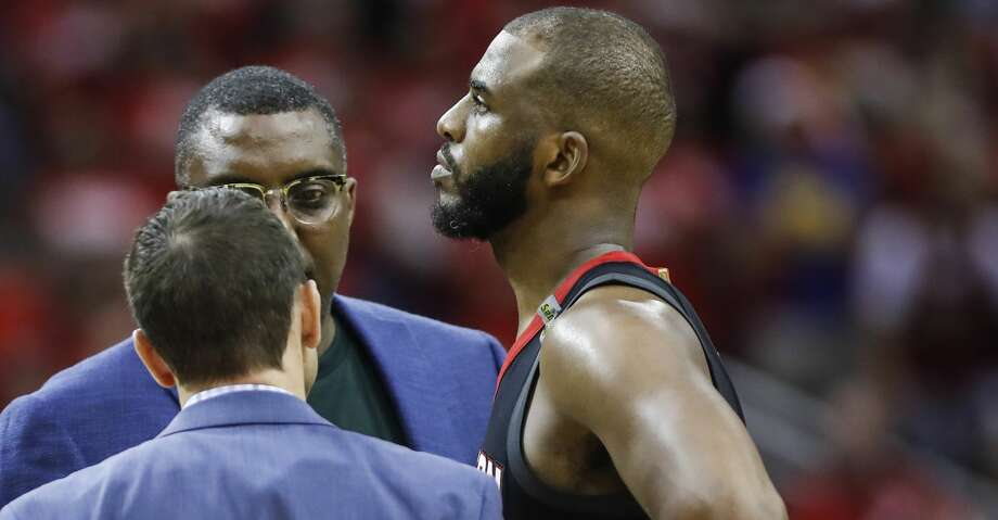Houston Rockets guard Chris Paul (3) talks to the Rockets training staff after suffering a hamstring injury during the second half of Game 5 of the NBA Western Conference Finals against the Golden State Warriors at Toyota Center on Thursday, May 24, 2018, in Houston. ( Brett Coomer / Houston Chronicle ) Photo: Brett Coomer/Houston Chronicle