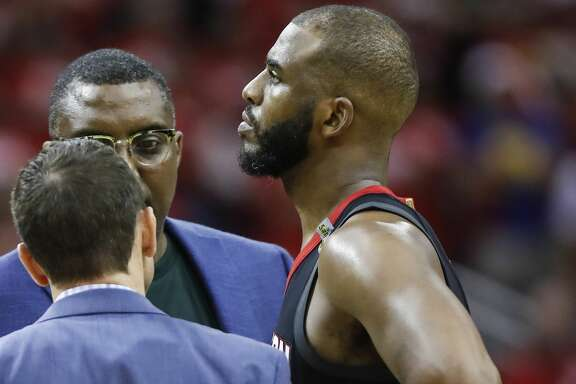 Houston Rockets guard Chris Paul (3) talks to the Rockets training staff after suffering a hamstring injury during the second half of Game 5 of the NBA Western Conference Finals against the Golden State Warriors at Toyota Center on Thursday, May 24, 2018, in Houston. ( Brett Coomer / Houston Chronicle )