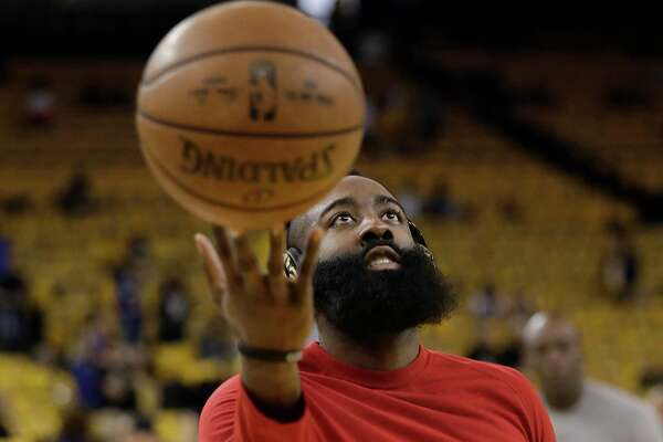Houston Rockets guard James Harden warms up before Game 6 of the NBA basketball Western Conference Finals between the Golden State Warriors and the Rockets in Oakland, Calif., Saturday, May 26, 2018. (AP Photo/Marcio Jose Sanchez)