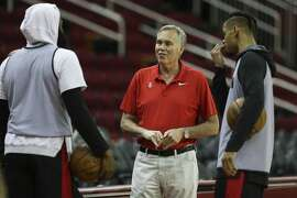Houston Rockets Head Coach Mike D'Antoni talks to James Harden, left, and Gerald Green during a practice on the court at Toyota Center before they take off to Oakland on Friday, May 18, 2018, in Houston.
