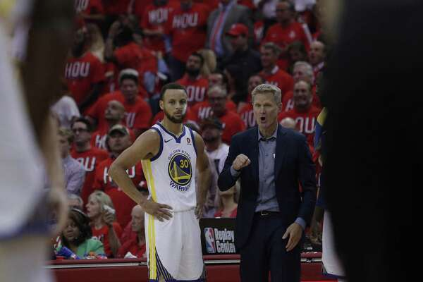 Stephen Curry (30) talks with head coach Steve Kerr during foul shot in the first half as the Golden State Warriors played the Houston Rockets in Game 1 of the Western Conference Finals at Toyota Center in Houston, Texas., on Monday, May 14, 2018.