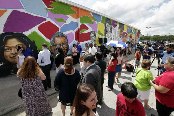 Attendants, officials and local dignitaries gather before the start of an unveiling ceremony for the new mural on the wall of the Gulfton Salvation Army building Saturday, May 26, 2018, in Houston, TX. (Michael Wyke / For the  Chronicle)
