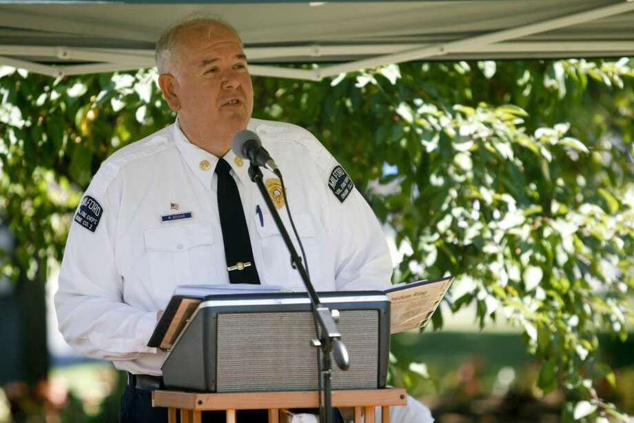 Assistant Fire Chief Robert Scukas speaks briefly at the Milford Green on Sunday, July 4, 2010 during a bell-ringing ceremony honoring the signing of the Declaration of Independence. Photo: Laura Buckman / Connecticut Post