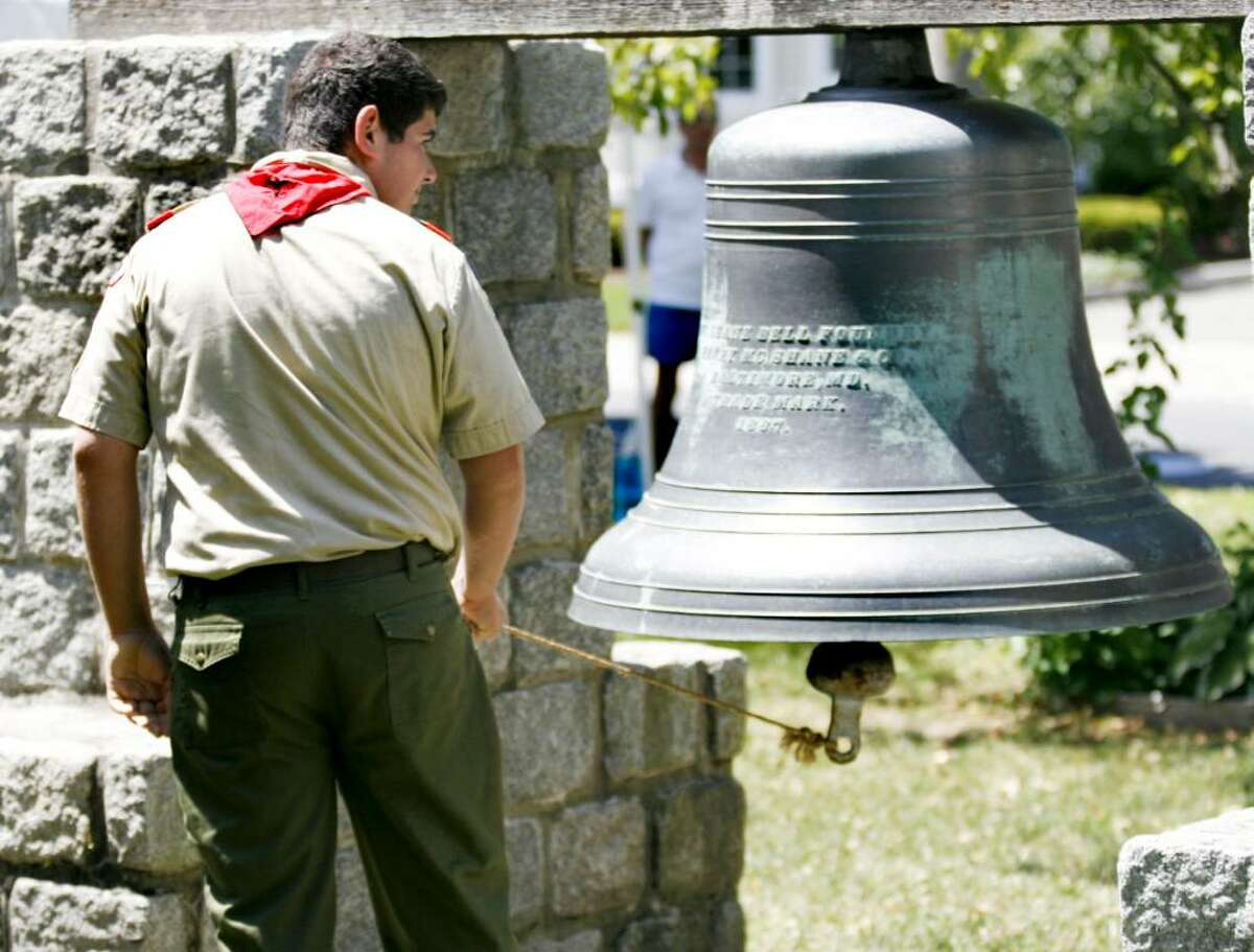 Adam Schwabacher of the Boy Scout troop 721 rings the bell on the Milford Green on Sunday, July 4, 2010 during a ceremony honoring the signing of the Declaration of Independence.