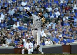 San Francisco Giants shortstop Brandon Crawford throws out Chicago Cubs' Willson Contreras at first during the fourth inning of a baseball game in Chicago, Saturday, May 26, 2018. (AP Photo/Nam Y. Huh)