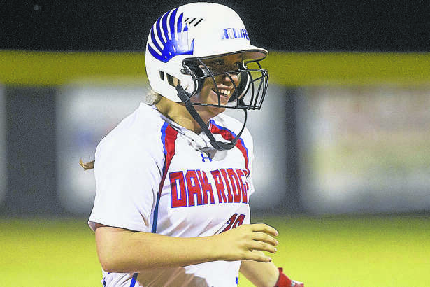 Oak Ridge's Autumn Sydlik smiles as she comes in after hitting a grand-slam in the sixth inning to break a three-run tie during a bi-district playoff game against Klein Oak Thursday. To view or purchase this photo and others like it, visit HCNpics.com.