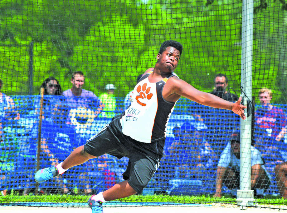 Edwardsville junior Amari Brooks makes his third throw during Saturday's finals in the discus at the Class 3A state meet at O'Brien Stadium in Charleston.
