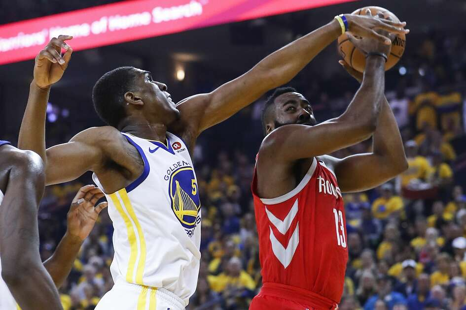 Golden State Warriors forward Kevon Looney (5) reaches out to defend a shot by Houston Rockets guard James Harden (13) during the first half of Game 6 of the NBA Western Conference Finals at Oracle Arena, Saturday, May 26, 2018, in Oakland.  ( Karen Warren  / Houston Chronicle )