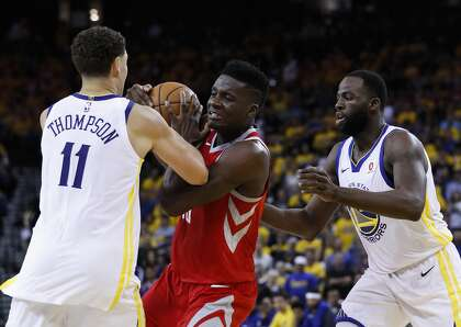 2251269e57d0 Rockets center Clint Capela (center) gets tangled up with Warriors guard Klay  Thompson and forward Draymond Green during the first half of Game 6 of the  NBA ...