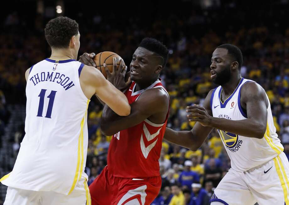 Rockets center Clint Capela (center) gets tangled up with Warriors guard Klay Thompson and  forward Draymond Green during the first half of Game 6 of the NBA Western Conference Finals on Saturday at Oracle Arena. Photo: Karen Warren/Houston Chronicle
