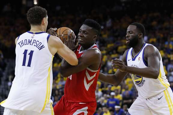 Houston Rockets center Clint Capela (15) gets tangled up with Golden State Warriors guard Klay Thompson (11) and  forward Draymond Green (23) during the first half of Game 6 of the NBA Western Conference Finals at Oracle Arena, Saturday, May 26, 2018, in Oakland.  ( Karen Warren  / Houston Chronicle )
