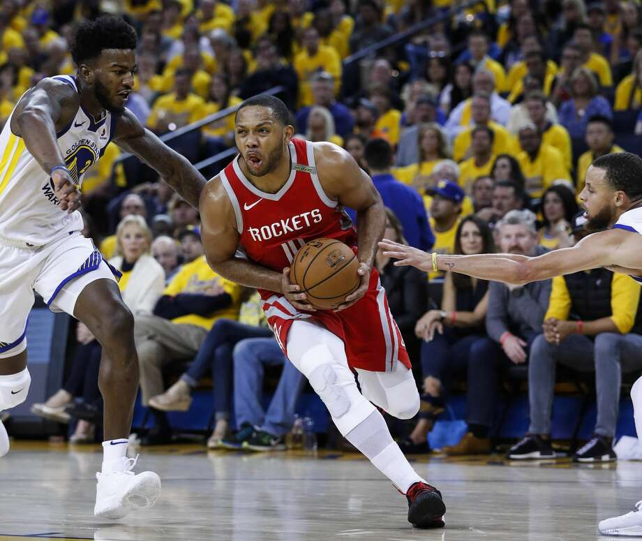 Houston Rockets guard Eric Gordon (10) takes the ball between Golden State Warriors center Jordan Bell (2) and guard Stephen Curry (30) during the first half of Game 6 of the NBA Western Conference Finals at Oracle Arena, Saturday, May 26, 2018, in Oakland.  ( Karen Warren  / Houston Chronicle ) Photo: Karen Warren/Houston Chronicle