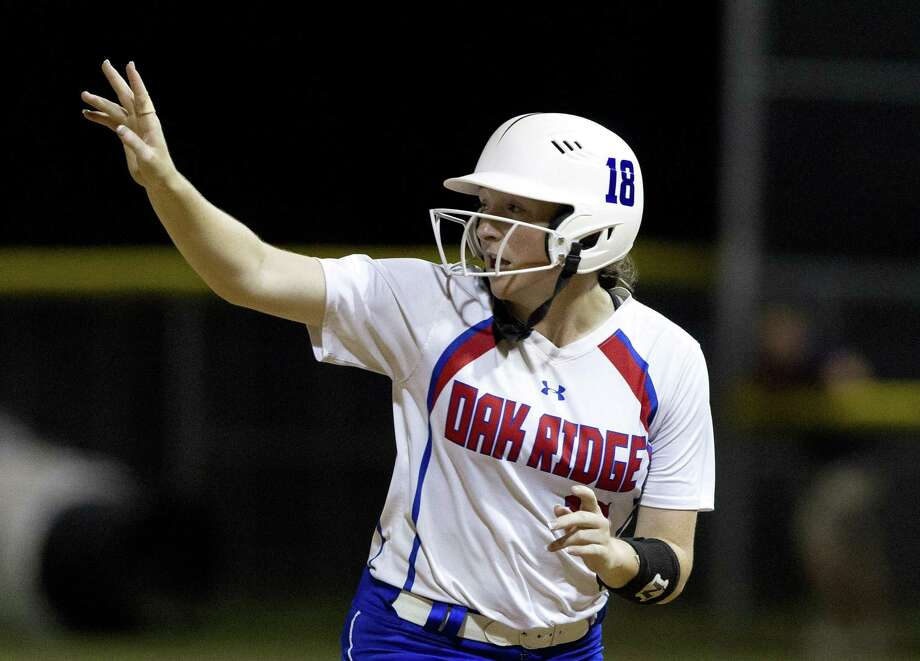 Oak Ridge courtesy runner Lauren Hastings motions toward the ball as Autumn Sydlik hits a two-run, walk-off home run in the ninth inning of Game 2 during a Region II-6A final on Saturday, May 26, 2018, in Tomball. Oak Ridge defeated Klein Collins 8-6 to advance to next week's state tournament. Photo: Jason Fochtman, Staff Photographer / Houston Chronicle / © 2018 Houston Chronicle