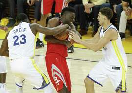 Golden State Warriors' Draymond Green tries to strip the ball from Houston Rockets' Clint Capela in the second quarter during game 6 of the Western Conference Finals between the Golden State Warriors and the Houston Rockets at Oracle Arena on Saturday, May 26, 2018 in Oakland, Calif.