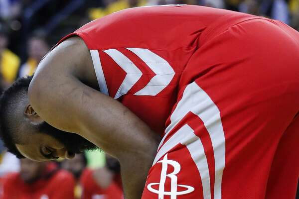Houston Rockets guard James Harden (13) bends over holding his hand during the first half of Game 6 of the NBA Western Conference Finals against the Golden State Warriors at Oracle Arena, Saturday, May 26, 2018, in Oakland.  ( Karen Warren  / Houston Chronicle )