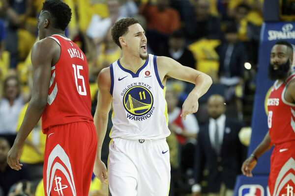 Golden State Warriors' Klay Thompson reacts in the third quarter during game 6 of the Western Conference Finals between the Golden State Warriors and the Houston Rockets at Oracle Arena on Saturday, May 26, 2018 in Oakland, Calif.