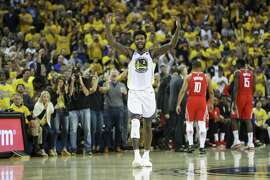 Golden State Warriors' Jordan Bell signals for the crowd to get louder in the third quarter during game 6 of the Western Conference Finals between the Golden State Warriors and the Houston Rockets at Oracle Arena on Saturday, May 26, 2018 in Oakland, Calif.