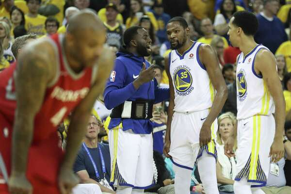 Golden State Warriors' Draymond Green talks to Kevin Durant in the third quarter during game 6 of the Western Conference Finals between the Golden State Warriors and the Houston Rockets at Oracle Arena on Saturday, May 26, 2018 in Oakland, Calif.