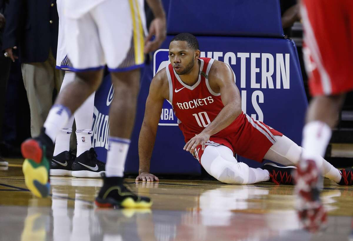 Houston Rockets guard Eric Gordon (10) gets up off the court after falling under the basket during the second half of Game 6 of the NBA Western Conference Finals against the Golden State Warriors at Oracle Arena, Saturday, May 26, 2018, in Oakland. ( Karen Warren / Houston Chronicle )