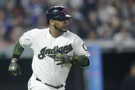 Cleveland Indians' Edwin Encarnacion runs the bases after hitting a two-run home run off Houston Astros starting pitcher Lance McCullers Jr. in the fifth inning of a baseball game, Saturday, May 26, 2018, in Cleveland. Jose Ramirez scored on the play. (AP Photo/Tony Dejak)