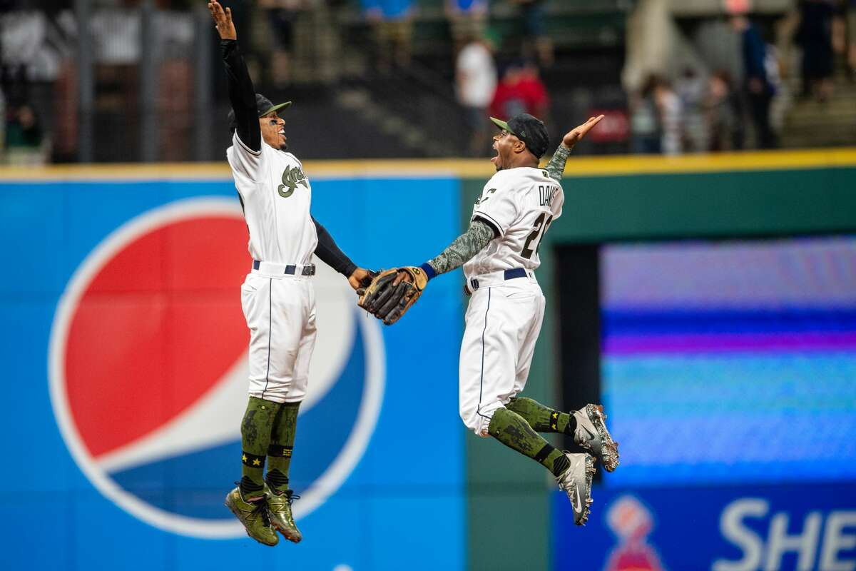 CLEVELAND, OH - MAY 26: Francisco Lindor #12 celebrates with Rajai Davis #26 of the Cleveland Indians after the Indians defeated the Houston Astros at Progressive Field on May 26, 2018 in Cleveland, Ohio. The Indians defeated the Astros 8-6. (Photo by Jason Miller/Getty Images)