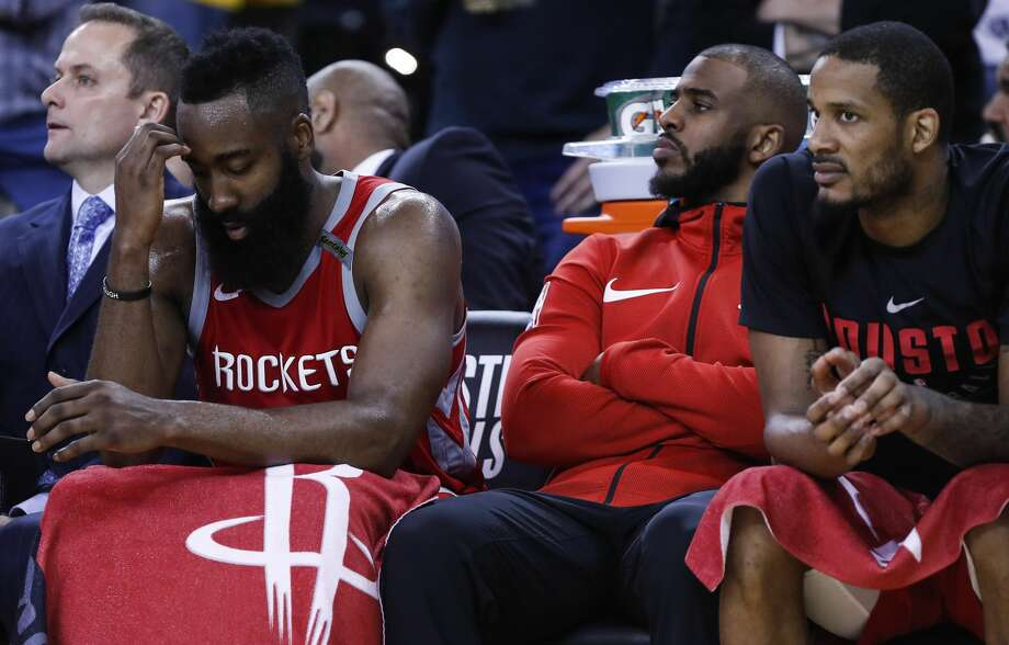 Houston Rockets guard James Harden, left,  guard Chris Paul, center, and forward Trevor Ariza sit on the bench during the fourth quarter of Game 6 of the NBA Western Conference Finals against the Golden State Warriors at Oracle Arena, Saturday, May 26, 2018, in Oakland.  ( Karen Warren  / Houston Chronicle ) Photo: Karen Warren/Houston Chronicle
