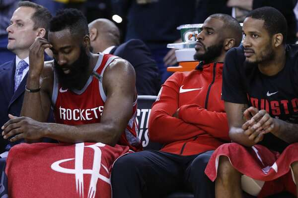 Houston Rockets guard James Harden, left,  guard Chris Paul, center, and forward Trevor Ariza sit on the bench during the fourth quarter of Game 6 of the NBA Western Conference Finals against the Golden State Warriors at Oracle Arena, Saturday, May 26, 2018, in Oakland.  ( Karen Warren  / Houston Chronicle )