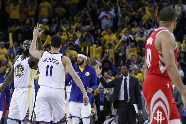 3of69Golden State Warriors forward Draymond Green (23) and guard Klay  Thompson (11) high five as they leave the court during a time out against  the Houston ... faa660dac