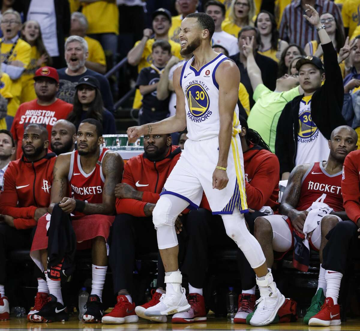 Golden State Warriors guard Stephen Curry (30) reacts after hitting a 3-pointer against the Houston Rockets during the fourth quarter of Game 6 of the NBA Western Conference Finals at Oracle Arena, Saturday, May 26, 2018, in Oakland. ( Karen Warren / Houston Chronicle )