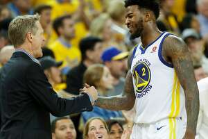 Golden State Warriors' head coach Steve Kerr congratulates Jordan Bell in the fourth quarter during game 6 of the Western Conference Finals between the Golden State Warriors and the Houston Rockets at Oracle Arena on Saturday, May 26, 2018 in Oakland, Calif.