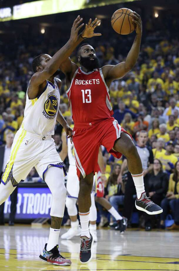 Rockets star James Harden, right, finished Saturday night with 32 points, but he scored none in the fourth quarter as Kevin Durant and the Warriors rolled to a 115-86 victory in Game 6. Photo: Karen Warren, Staff / Houston Chronicle / © 2018 Houston Chronicle