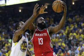 Houston Rockets guard James Harden (13) drives past Golden State Warriors forward Kevin Durant (35) for a layup during the first half of Game 6 of the NBA Western Conference Finals at Oracle Arena, Saturday, May 26, 2018, in Oakland. ( Karen Warren / Houston Chronicle )
