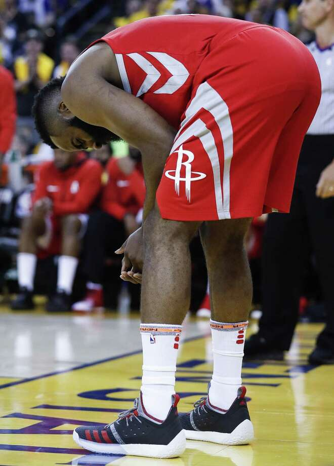 Houston Rockets guard James Harden (13) bends over holding his hand during the first half of Game 6 of the NBA Western Conference Finals against the Golden State Warriors at Oracle Arena, Saturday, May 26, 2018, in Oakland.  ( Karen Warren  / Houston Chronicle ) Photo: Karen Warren, Staff / Houston Chronicle / © 2018 Houston Chronicle
