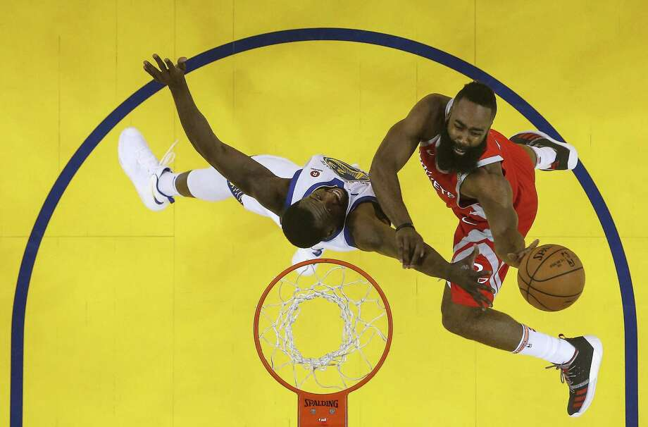 Houston Rockets guard James Harden (13) goes up for a basket against Golden State Warriors forward Draymond Green (23) during the first half of Game 6 of the NBA Western Conference Finals at Oracle Arena, Saturday, May 26, 2018, in Oakland.  ( Karen Warren  / Houston Chronicle ) Photo: Karen Warren, Staff / Houston Chronicle / © 2018 Houston Chronicle