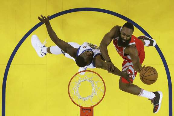 Houston Rockets guard James Harden (13) goes up for a basket against Golden State Warriors forward Draymond Green (23) during the first half of Game 6 of the NBA Western Conference Finals at Oracle Arena, Saturday, May 26, 2018, in Oakland.  ( Karen Warren  / Houston Chronicle )