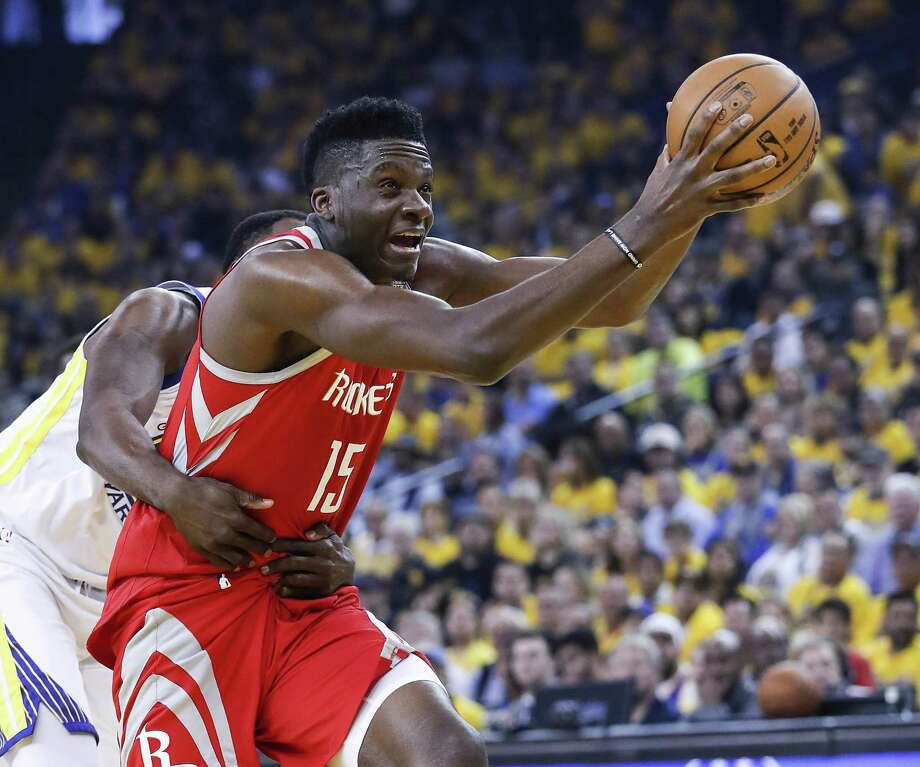 Rockets center Clint Capela is grabbed from behind by the Warriors' Draymond Green in the first half Saturday night. Capela had 15 rebounds but only two points. Photo: Karen Warren, Staff / Houston Chronicle / © 2018 Houston Chronicle