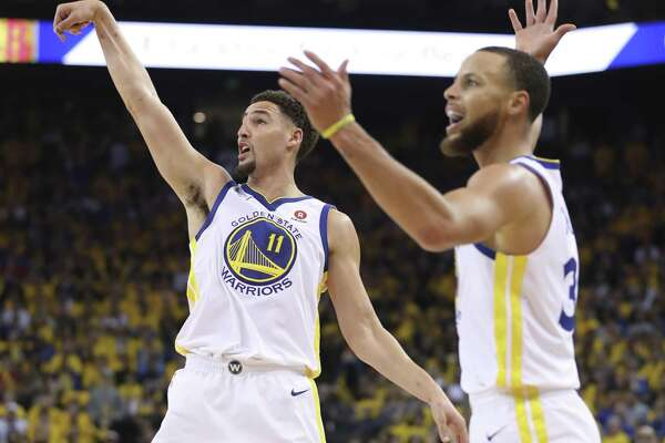 Golden State Warriors' Klay Thompson watches a three-point attempt in the second quarter during game 6 of the Western Conference Finals between the Golden State Warriors and the Houston Rockets at Oracle Arena on Saturday, May 26, 2018 in Oakland, Calif.
