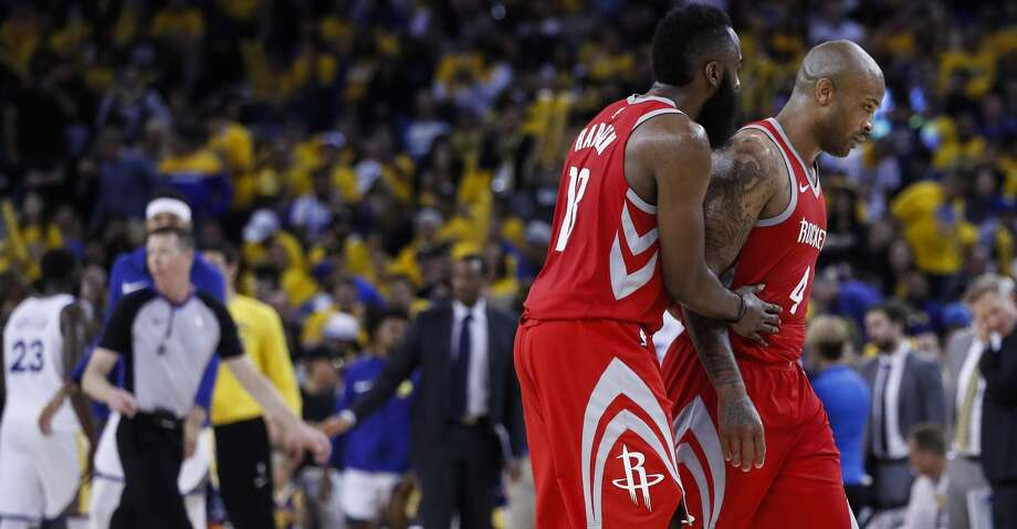 Houston Rockets guard James Harden (13) and forward PJ Tucker (4) walk off the court during a time out against the Golden State Warriors during the second half of Game 6 of the NBA Western Conference Finals at Oracle Arena, Saturday, May 26, 2018, in Oakland.  ( Karen Warren  / Houston Chronicle ) Photo: Karen Warren/Houston Chronicle