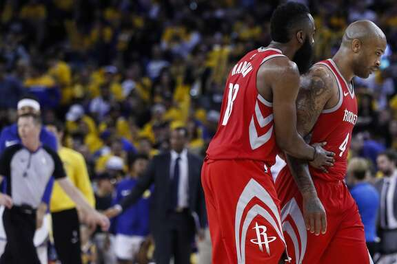Houston Rockets guard James Harden (13) and forward PJ Tucker (4) walk off the court during a time out against the Golden State Warriors during the second half of Game 6 of the NBA Western Conference Finals at Oracle Arena, Saturday, May 26, 2018, in Oakland.  ( Karen Warren  / Houston Chronicle )