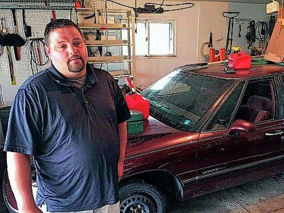 Frankie Roark discusses the death of his uncle, Frank Roark Jr., 54. His uncle took his own life in the garage, the same site where his uncle's wife killed herself a dozen years previous. Photo:       Phil Luciano | Journal Star (AP)